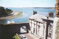 a view over the Menai Strait to south Anglesey from a tower of Caernarfon castle